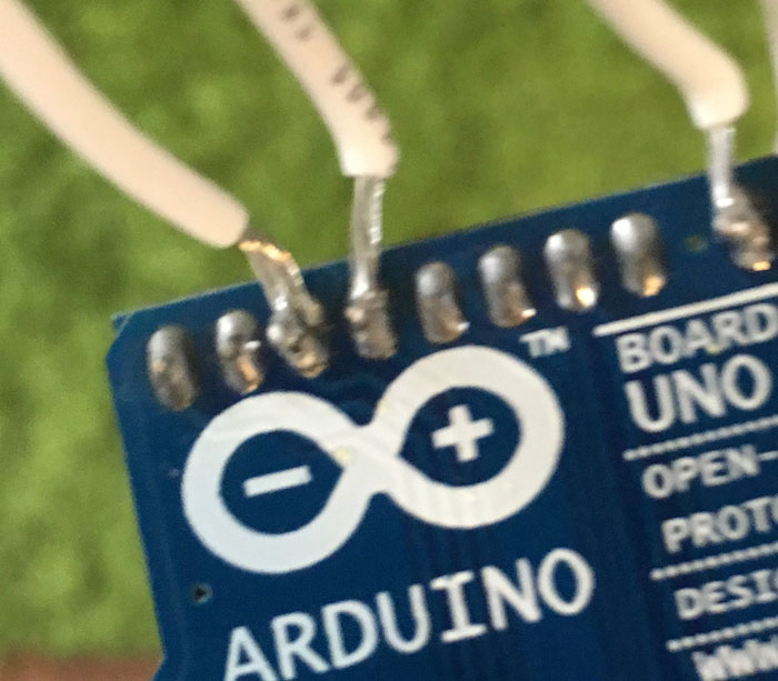Arduino with bad solder job soldering wires directly to rear of board